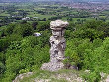220px-Devils.chimney.at.leckhampton.arp.jpg