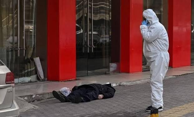 China-Man-found-dead-on-empty-Wuhan-street-amid-virus-outbreak.jpg