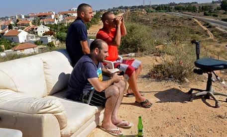 Israelis lounge as Gaza is bombed.JPG