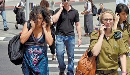 Israelis-on-the-phone-in-Tel-Aviv.jpg