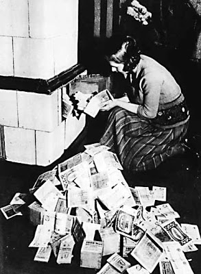 Weimar-Republic-Lady-Using-Money-To-Heat-Home-1923.jpg