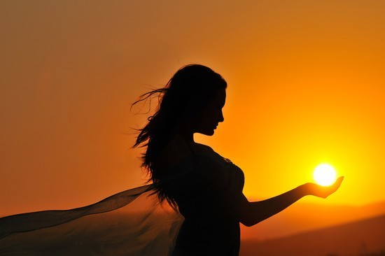 woman-sunset-sunrise-silhouette-holding-sunball.png