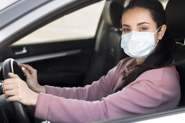 woman-wearing-medical-mask-car_23-2148510560.jpg
