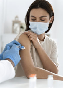 young-woman-being-vaccinated-214x300.jpeg
